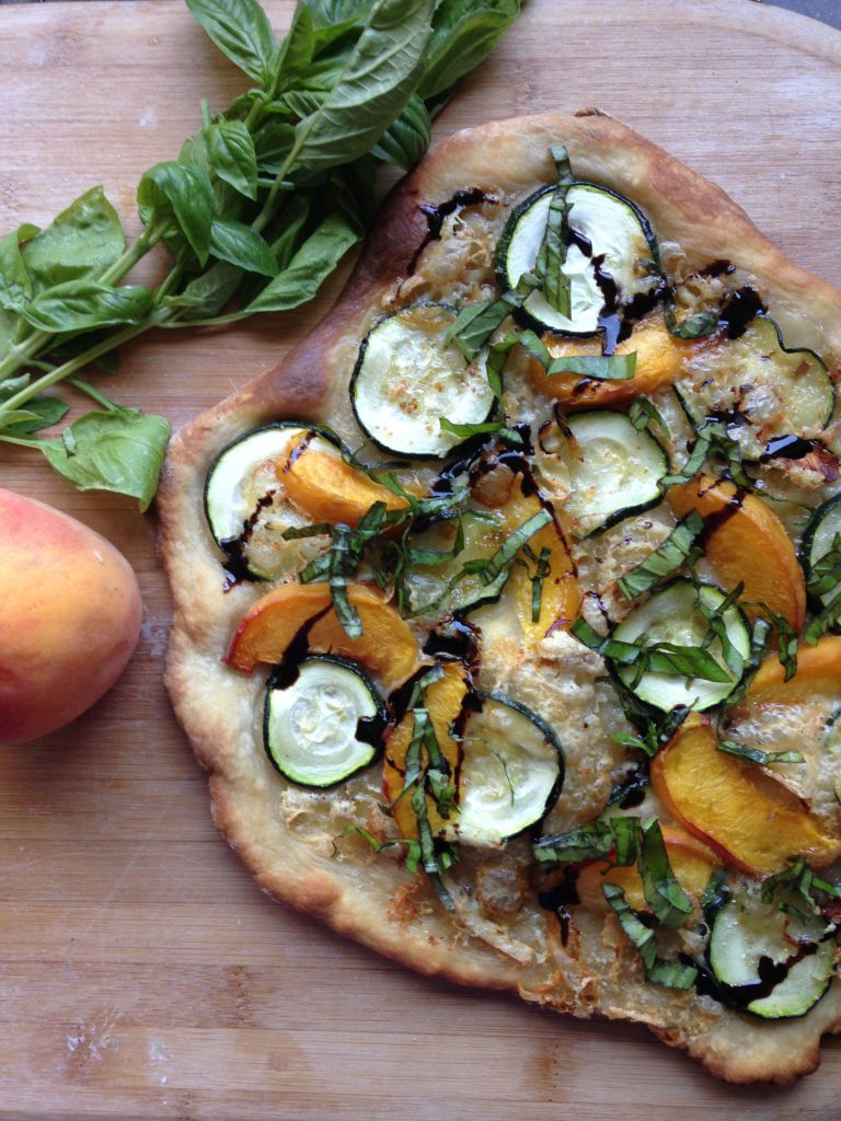 Peach, zucchini, and basil pizza