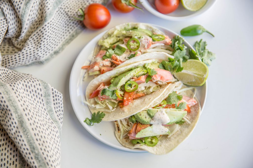 Plate with three chili lime salmon tacos