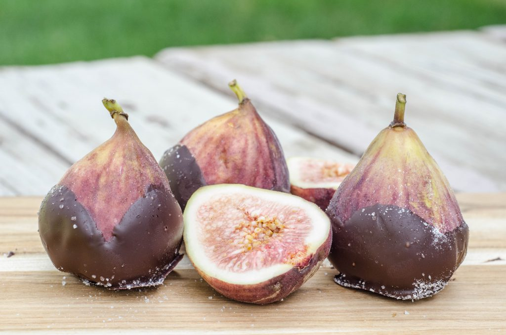 Dark Chocolate Dipped Figs with Sea Salt 6 fresh figs 8 ounces dark chocolate, melted Sea salt Place parchment paper on a plate or small baking sheet. Chop or break up chocolate and place in small glass bowl. Microwave for 30 seconds. Stir and repeat until the chocolate is melted. Dip the bottom third of each fig into the melted chocolate. Place on parchment paper and sprinkle chocolate with sea salt.