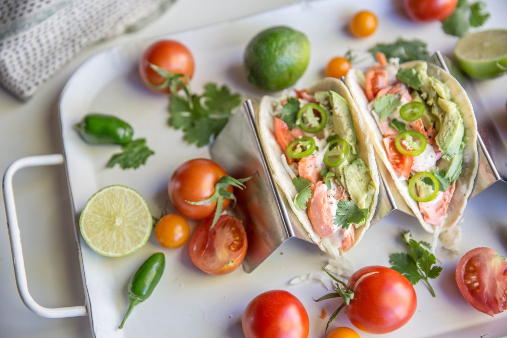 Tray with two chili lime salmon tacos
